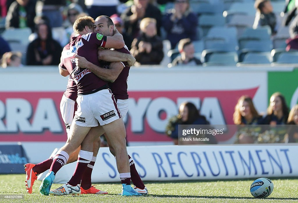Brett Stewart of the Sea Eagles celebrates scoring the match winning try with Daly Cherry-Evans during the round 23 NRL match between the Canberra Raiders and the Manly Warringah Sea Eagles at GIO Stadium on August 16, 2015 in Canberra, Australia.