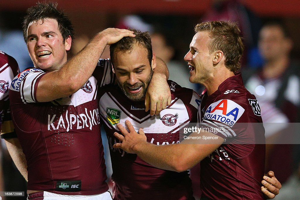 Brett Stewart of the Sea Eagles is congratulated after scoring a try during the round two NRL match between the Manly Sea Eagles and the Newcastle Knights at Brookvale Oval on March 17, 2013 in Sydney, Australia.