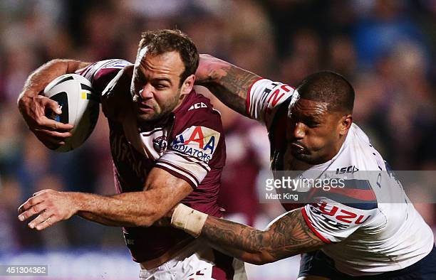 Brett Stewart of the Sea Eagles is tackled by FrankPaul Nuuausala of the Roosters during the round 16 NRL match between the Manly Warringah Sea...