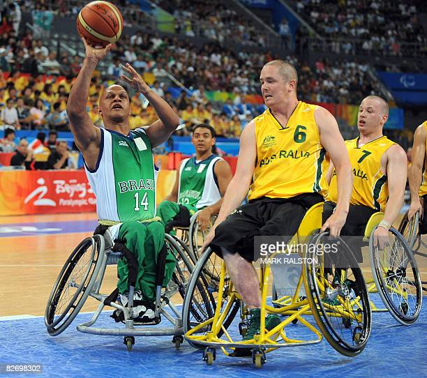 Brett Stibners and Shaun Norris of Australia try to defend against Sergio Alexandre of Brazil in their Group B basketball game at the 2008 Beijing...