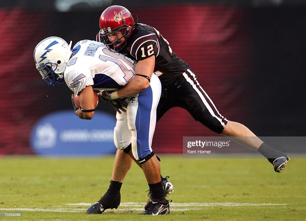 Brett Sturm #12 of the San Diego State Aztecs tackles Justin Handley #18 of the Air Force Falcons on October 21, 2006 at Qualcomm Stadium in San Diego, California. San Diego State won 19-12.