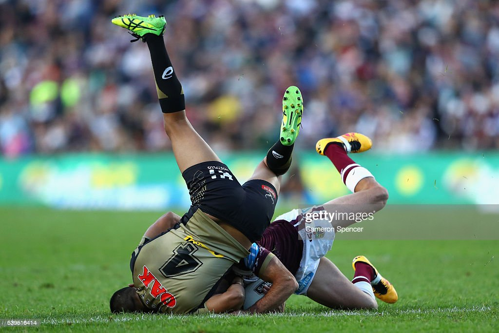 Brett Stwart of the Sea Eagles is tackled by Tyrone Peachey of the Panthers during the round 14 NRL match between the Manly Sea Eagles and the Penrith Panthers at Brookvale Oval on June 12, 2016 in Sydney, Australia.