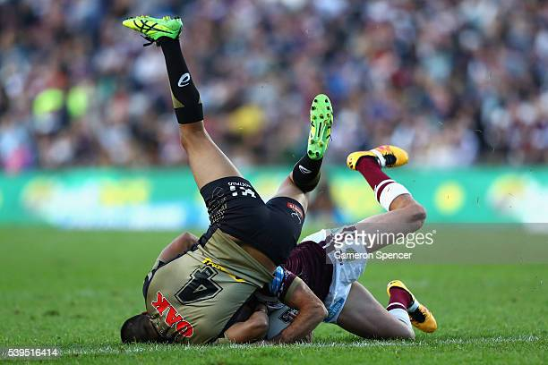 Brett Stwart of the Sea Eagles is tackled by Tyrone Peachey of the Panthers during the round 14 NRL match between the Manly Sea Eagles and the...