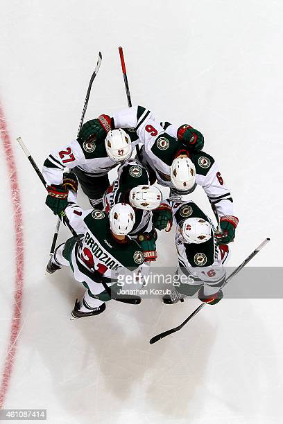Brett Sutter, Marco Scandella, Justin Fontaine, Kyle Brodziak and Jared Spurgeon of the Minnesota Wild celebrate a second period goal against the...