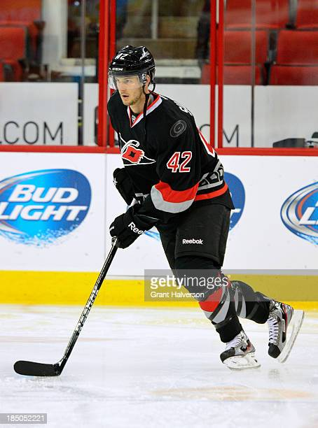 Brett Sutter of the Carolina Hurricanes against the Phoenix Coyotes during play at PNC Arena on October 13, 2013 in Raleigh, North Carolina. The...
