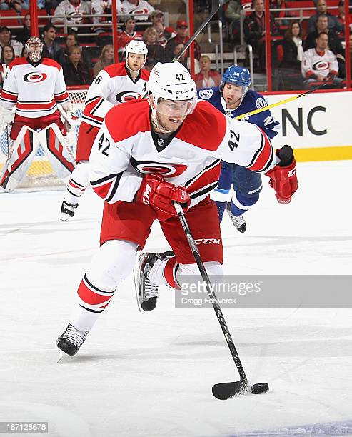 Brett Sutter of the Carolina Hurricanes moves the puck during their NHL game against the Tampa Bay Lightning at PNC Arena on November1, 2013 in...