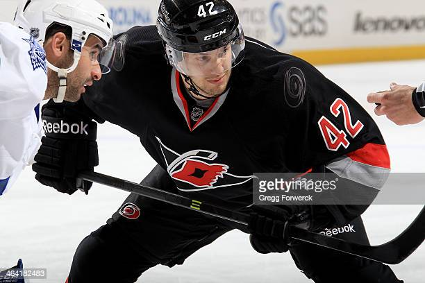 Brett Sutter of the Carolina Hurricanes prepares for a faceoff against Nazam Kadri of the Toronto Maple Leafs during their NHL game at PNC Arena on...