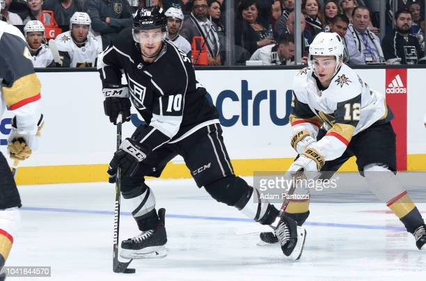 Brett Sutter of the Los Angeles Kings skates with the puck while pursued by Erik Brannstrom of the Vegas Golden Knights during the third period of...