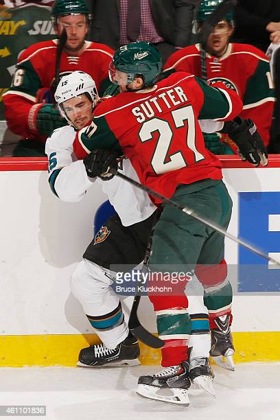 Brett Sutter of the Minnesota Wild checks James Sheppard of the San Jose Sharks during the game on January 6, 2015 at the Xcel Energy Center in St....