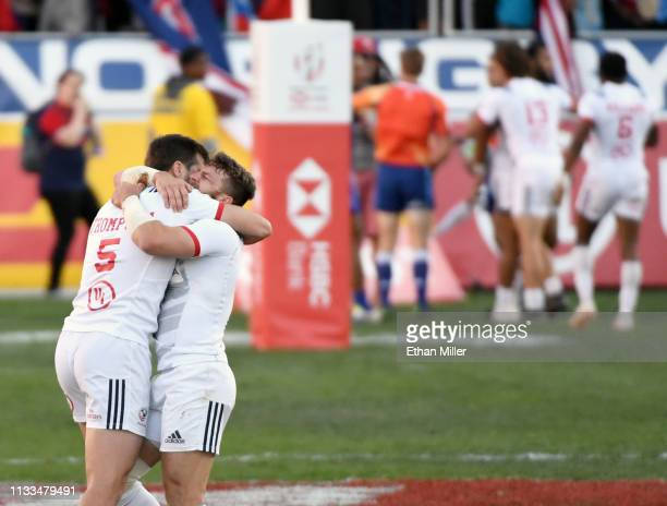 Brett Thompson and Steve Tomasin of the United States hug on the pitch at the end of their 270 Cup Final match victory over Samoa at the USA Sevens...
