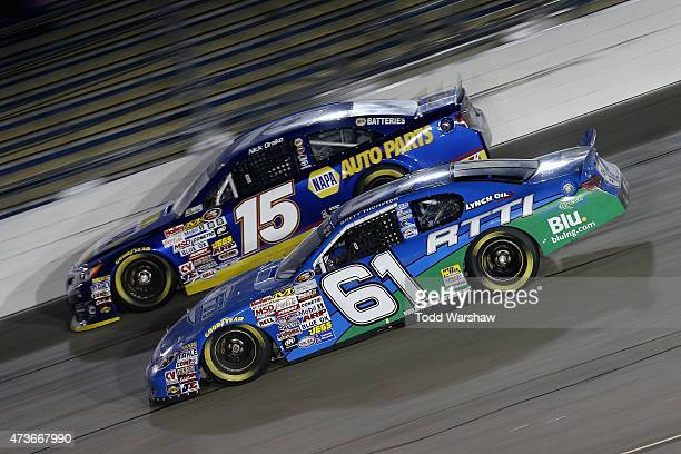 Brett Thompson driver of the RTTI/61 Logistics/BluLNGcom Chevrolet races Nick Drake driver of the NAPA Auto Parts Toyota during the NASCAR KN Pro...