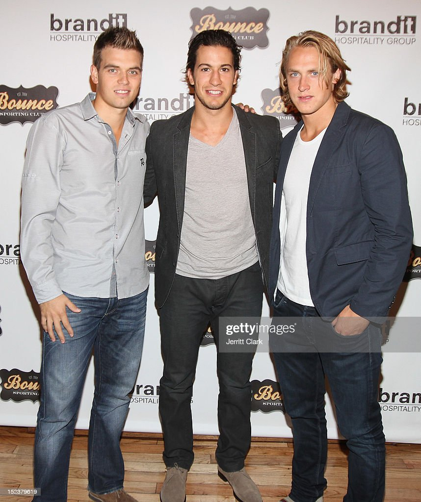 Brett Valliquette, Michael Del Zotto and Carl Hagelin attend the 1 year anniversary party at Bounce Sporting Club on September 19, 2012 in New York City.