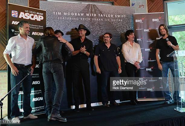 Brett Warren Keith Urban Mark Irwin Tim McGraw Byron Gallimore Scott Borchetta and Brad Warren Celebrate Tim McGraw's MultiWeek No1 Highway Don't...