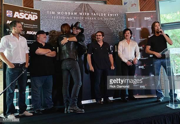 Brett Warren Mark Irwin Keith Urban Tim McGraw Byron Gallimore Scott Borchetta and Brad Warren Celebrate Tim McGraw's MultiWeek No1 'Highway Don't...