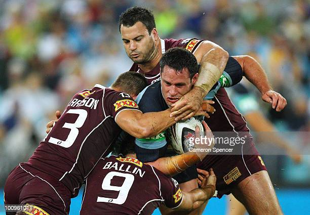 Brett White of the Blues is tackled during game one of the ARL State of Origin series between the New South Wales Blues and the Queensland Maroons at...