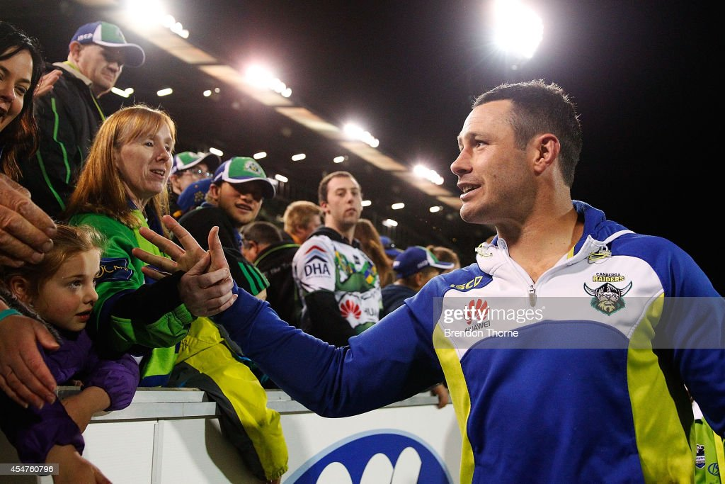 Brett White of the Raiders farewells fans on his lap of honour during the round 26 NRL match between the Canberra Raiders and the Parramatta Eels at GIO Stadium on September 6, 2014 in Canberra, Australia.
