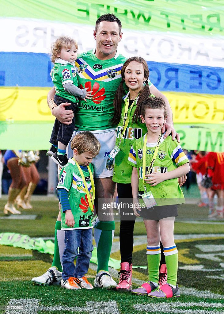 Brett White of the Raiders poses with his children prior to the round 26 NRL match between the Canberra Raiders and the Parramatta Eels at GIO Stadium on September 6, 2014 in Canberra, Australia.