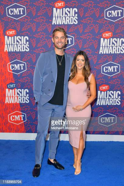 Brett Young and Taylor Mills attend the 2019 CMT Music Awards at Bridgestone Arena on June 05 2019 in Nashville Tennessee