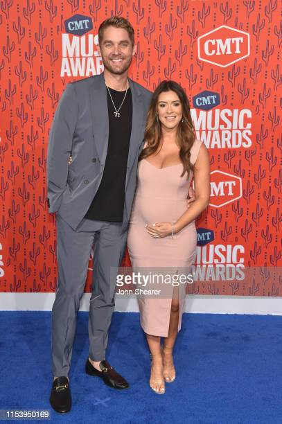 Brett Young and wife Taylor Mills attend the 2019 CMT Music Awards at Bridgestone Arena on June 05 2019 in Nashville Tennessee