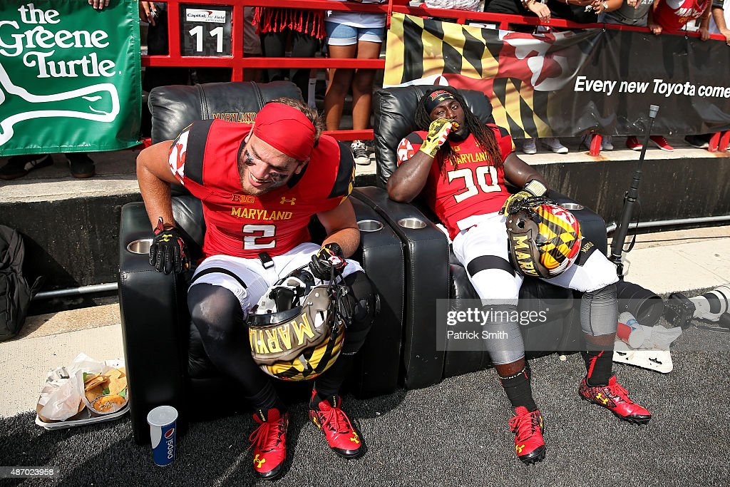 Brett Zanotto #38 of the Maryland Terrapins and Milan Collins #2 of the Maryland Terrapins sit in chairs after defeating the Richmond Spiders at Byrd Stadium on September 5, 2015 in College Park, Maryland. The Maryland Terrapins won, 50-21.