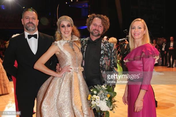 Breuninger Leipzig Marcus Kahl model LOB Fashion Award winner designer Denny Rauner and Ayleena Jung pose at the 25th Leipzig Opera Ball La Dolce...