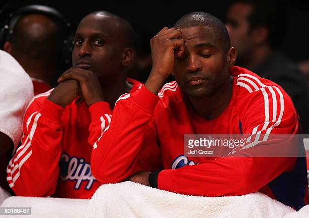 Brevin Knight and Cuttino Mobley of the Los Angeles Clippers look dejected on the bench during the fourth quarter against the Los Angeles Lakers at...