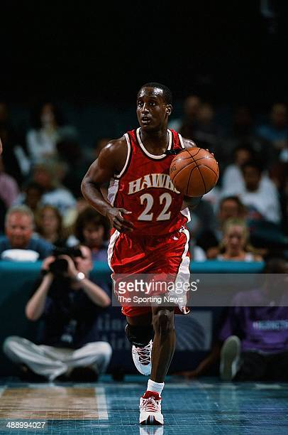Brevin Knight of the Atlanta Hawks brings the ball upcourt during the game against the Charlotte Hornets on April 16 2001 at Charlotte Coliseum in...