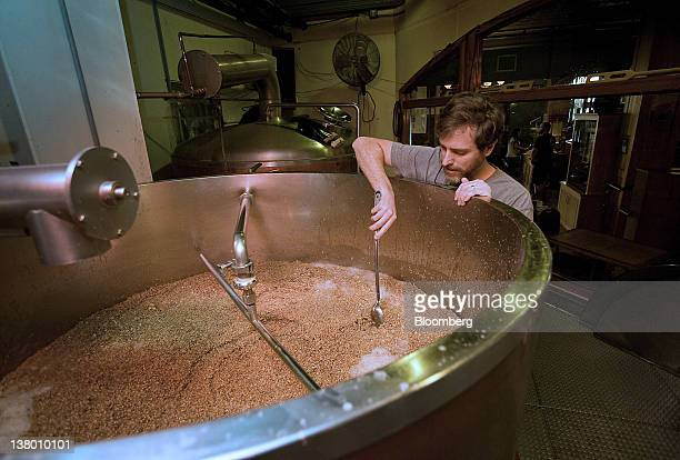 Brewer Brad Landman checks the contents of the Mash Tun at the Wynkoop Brewing Co in Denver Colorado US on Thursday Jan 26 2012 The Wynkoop Brewing...