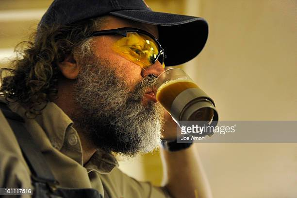 Brewer Kent Reichow tastes the wort after going through a filter press and on it's way to the brewing tank during a brewing day for Colorado Native...