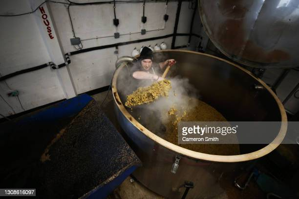 Brewer, Neil Charters digs out the hop back at Skinner's Brewery on March 23, 2021 in Truro, England. The independent Cornish brewery struggled to...