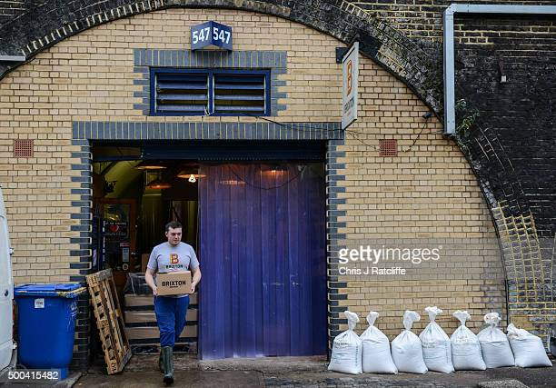 Brewer Robin Bortzler carries out a finished crate of Atlantic APA at inner city craft beer makers Brixton Brewery on December 8 2015 in London...