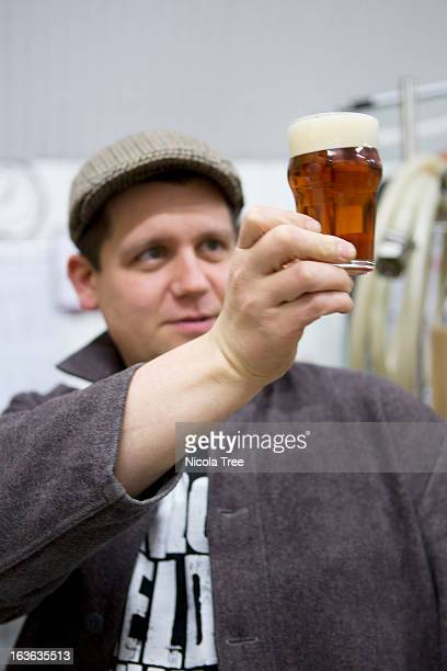 brewer tasting and checking beers clarity - the brewery london stock photos and pictures