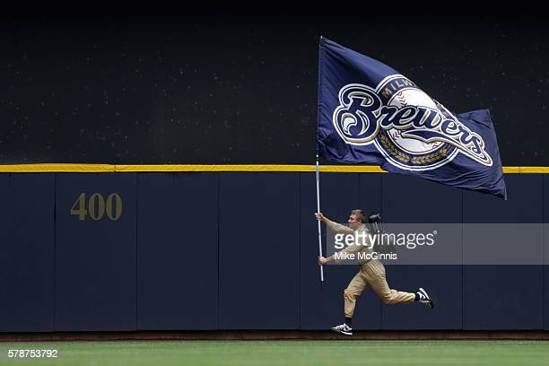 Brewers fan squad runs in a Ghostbusters uniform runs along the outfield wall before the game against the St Louis Cardinals and the Milwaukee...