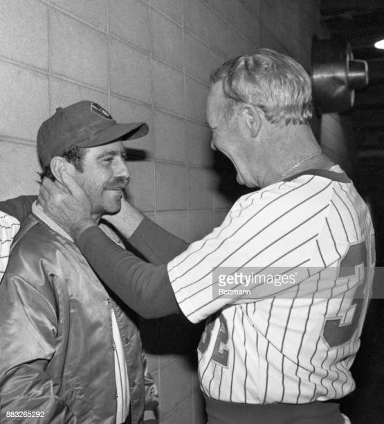Brewers' manager Harvey Kuenn has a special caress for pitcher Mike Caldwell after victory over the Cardinals gave Milwaukee a 32 game lead in the...