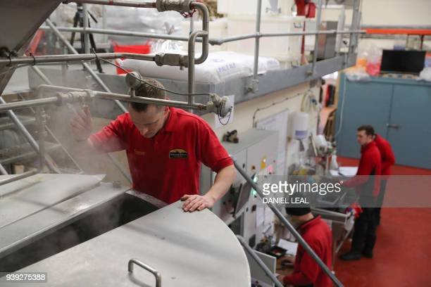 Brewery operator Steve looks inside a container boiling malt at the Windsor Eton Brewery in Windsor England on March 28 2018 A brewery in Windsor the...