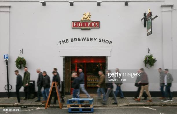 Brewery visitors walk past the Brewery shop at Fuller's Griffin Brewery in Chiswick west London on January 26 2019 Japanese brewer Asahi has agreed...