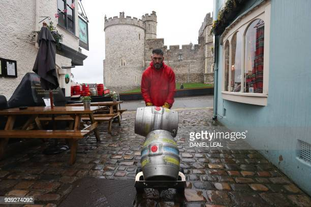 Brewery worker Paul delivers barrels of the new Harry Meghan's Windsor Knot ale a limited edition craft beer brewed to mark the royal wedding of...