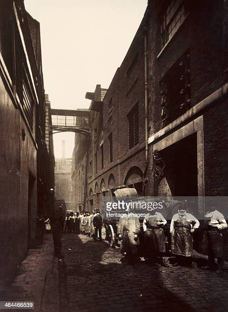 Brewery workers outside the Combe Co's Brewery Castle Street St Giles Circus London c1875