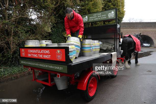 Brewey worker Paul loads barrels of the new Harry Meghan's Windsor Knot ale a limited edition craft beer brewed to mark the royal wedding of Prince...