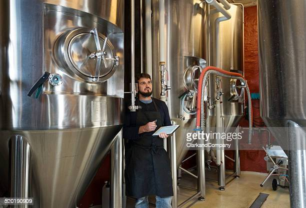 brewmaster checking his brew - storage tank stock pictures, royalty-free photos & images