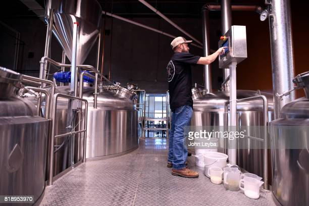 Brewmaster Josh Robbins of New Terrain Brewing art the control console as he brews a Colorado IPA on July 19 2017 at New Terrain Brewing in Golden...
