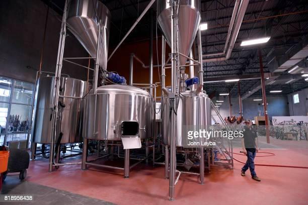 Brewmaster Josh Robbins of New Terrain Brewing brews a Colorado IPA on July 19 2017 at New Terrain Brewing in Golden Josh says his 'Colorado IPA is a...