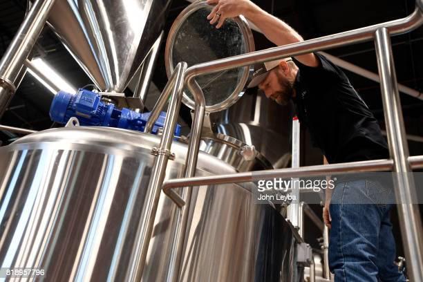 Brewmaster Josh Robbins of New Terrain Brewing brews a Colorado IPA on July 19 2017 at New Terrain Brewing in Golden Josh says his Colorado IPA is a...