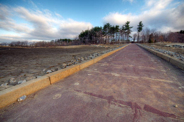 Brewster Reservoir Off Old Milltown Road Spring Drought, launching ramp, red pavement, curbs, mud, r