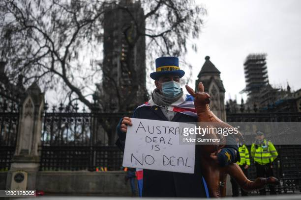 Brexit activist Steve Bray is seen holding an inflatable kangaroo and a sign reading 'Australia Deal is No Deal' outside the Houses of Parliament on...