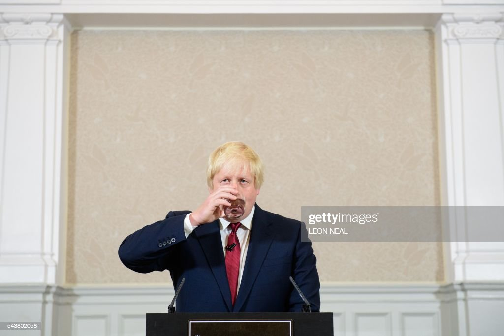 Brexit campaigner and former London mayor Boris Johnson takes a drink as he addresses a press conference in central London on June 30, 2016. Top Brexit campaigner and former London mayor Boris Johnson said Thursday he will not stand to succeed Prime Minister David Cameron, as had been widely expected after Britain's vote to leave the European Union. The British pound spiked Thursday immediately after Boris Johnson said he will not stand in the Conservative leadership race. / AFP / LEON
