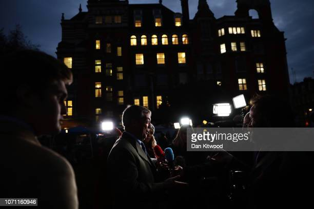 Brexit campaigner and member of the European Parliament Nigel Farage talks to the media in Westminster on December 10 2018 in London England The...