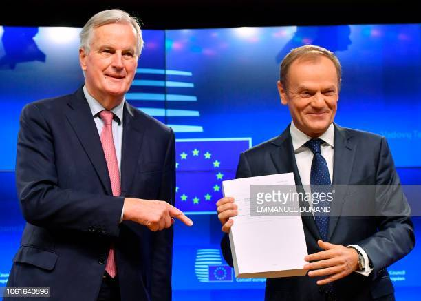 EU Brexit chief negociator Michel Barnier hands over to European Council President Donald Tusk the draft agreement of the withdrawal of the United...