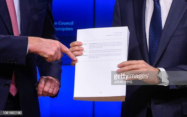 EU Brexit chief negociator Michel Barnier hands over to European Council President Donald Tusk the 'draft agreement of the withdrawal of the United...
