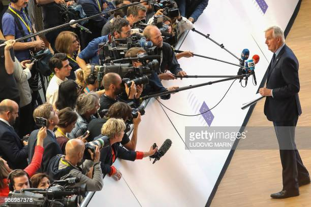 Brexit Chief Negotiator Michel Barnier speaks to journalists during the last day of the European Union leaders' summit, without Britain, to discuss...